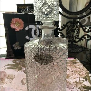 Glass bottle with etched detail and vodka sign
